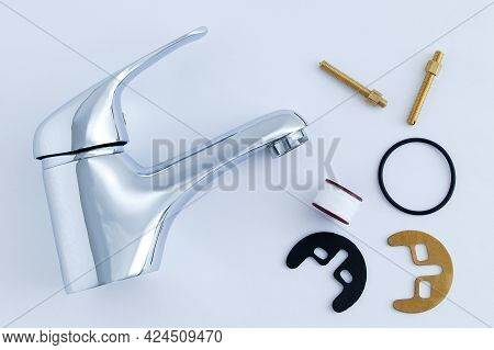 Plumbing Chrome Faucet And Fixing Set With Gasket On A White Background.