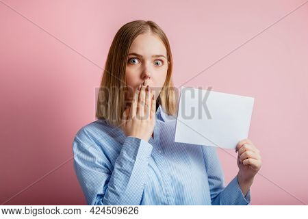 Emotional Portrait Of Surprised Young Woman Show Empty Mockup Copy Space White Card. Blonde Woman In