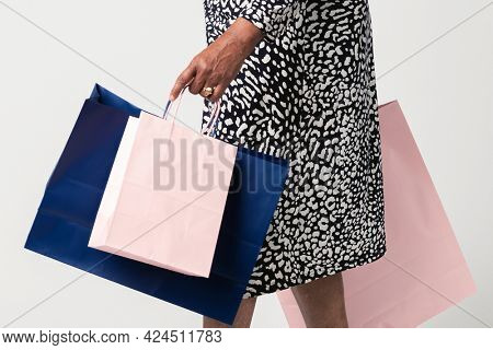 Black woman carrying shopping bag
