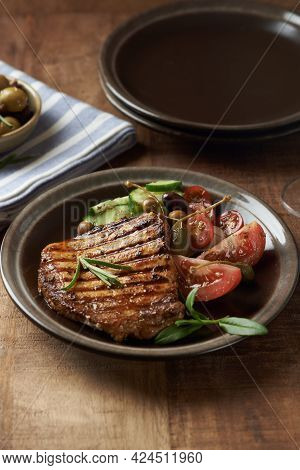 Grilled Turkey Breast With Fresh Salad. Wooden Background. Copy Space.