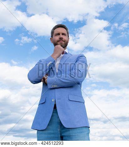 Thoughtful Businessperson In Formalwear. Business Success. Successful Boss In Suit.