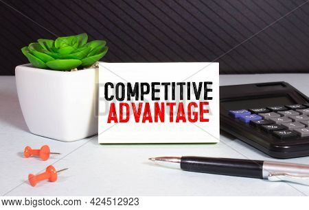 Business Man Pointing To Transparent Board With Text: Competitive Advantage,