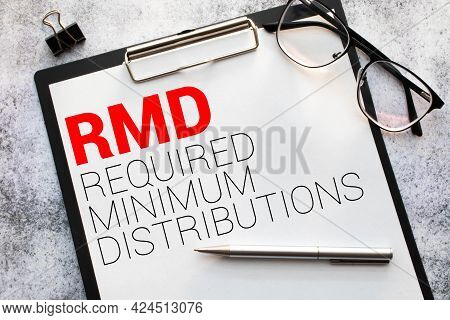 Paper With Required Minimum Distributions Rmd On A Table.