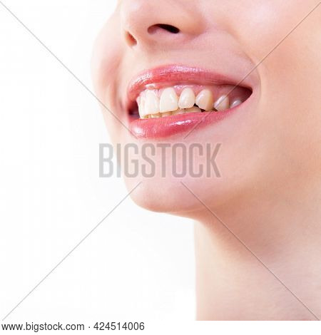 Smile. healthy and beautiful. Laughing woman, female mouth with great teeth over white background. Teeth health, whitening, prosthetics and care. Happiness and joy