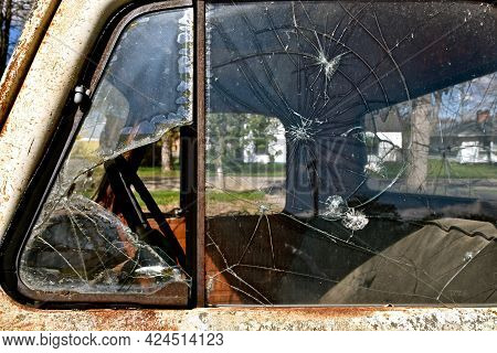 The Windows Of An Old Pickup Are Shattered And Broken.
