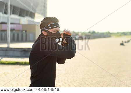 Fighter Man Training Boxing Punch On Urban Street. Portrait Of Fitness Man Boxing Outdoor At Black R