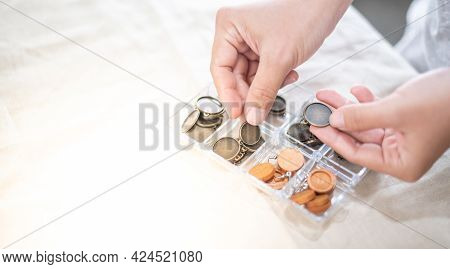 The Female Hands Holding And Choosing The Metal Plate Frame Earring Or Pendant For Embroidery Thread