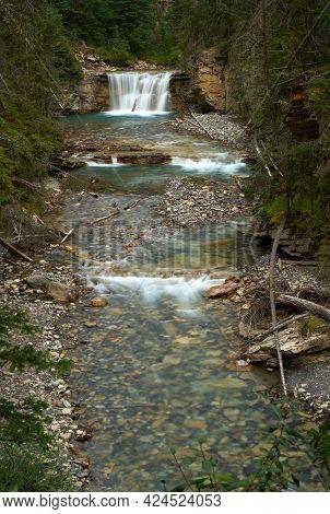 Johnston Canyon Waterfall Canada Vertical. Rugged Johnston Canyon In Banff National Park, Alberta, C