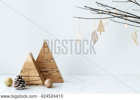 Wooden triangle showpiece on a marble table