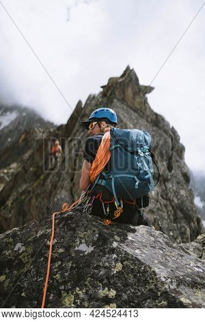 Rock climber going up the Chamonix Alps in France