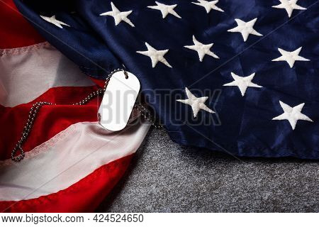 America United States Flag And Chain Dog Tags, Military Symbolizing, Studio Shot On Concrete Board B
