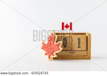 Canada Day Date Block With Maple Leaf Flag And Sugar Cookie.