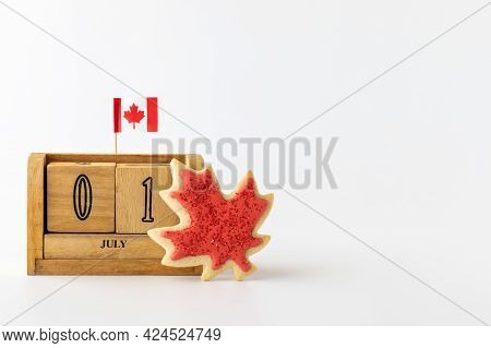 Close Up Of A Date Block Showing July First Representing Canada With A Small Canada Flag Pick And Ma