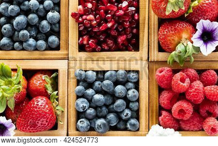 Top Down Macro Close Up Of Wooden Crates Filled With Various Berries.