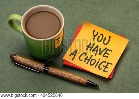 You have a choice reminder note with a cup of coffee, business, education and personal development concept