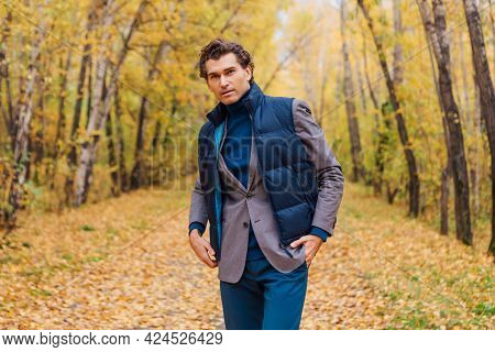 Tall Handsome Man Walking In The Autumn Alley