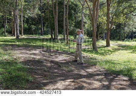 Mackay, Queensland, Australia - June 2021: An Active Senior Pensioner Operating The Controls Of A Dr
