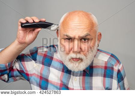 Middle Aged Bald Man Hair Clipper, Mature Baldness And Hair Loss Concept.