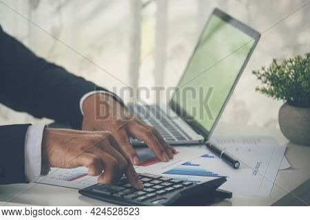 Close Up Business Man Hands Using Calculator Counting Tax Financial Bill. Man Hands Calculating Numb
