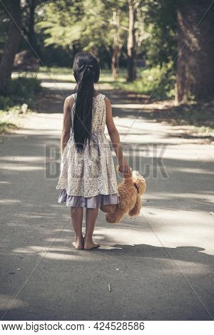 Sad Girl Hugging Teddy Bear Sadness Alone In Green Garden Park. Lonely Girl Feeling Sad Unhappy Walk