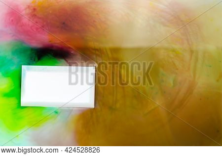 Blank White Business Card With Wet Edges On A Multicolored Abstract Background. Rectangular Business