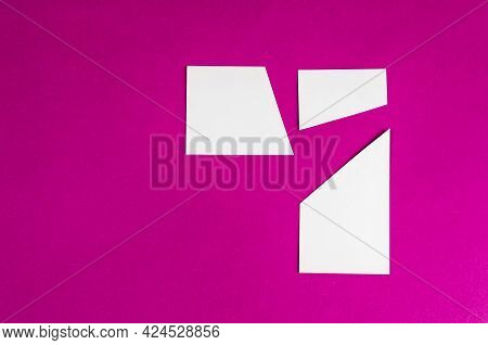 Random White Geometric Shapes On Pink. Trapezes. Top View. Copy Space