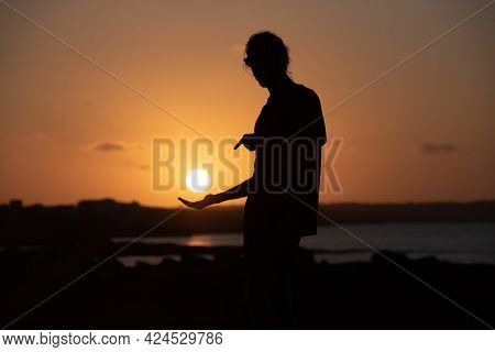 Young Man On The Pier Of Es Calo De Sant Aug The Balearic Islands Of The Mediterranean In Es Calo, F