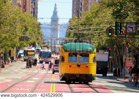 June 8, 2021 In San Francisco, Ca:  Vintage Street Car Riding Towards The Ferry Building On Market S