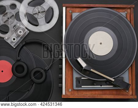 Retro Vinyl Record Player With Records, Audio Magnetic Reel, Audio Cassette And Stereo Headphones On