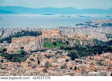View Of The Acropolis Of Athens Seen From Lycabettus Hill. The Filopappos Hill And The Saronic Gulf,
