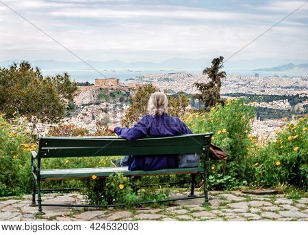 Athens, Greece - April 4 2015: Defocused Unidentified Seated Man Enjoys The View From Lycabettus Hil