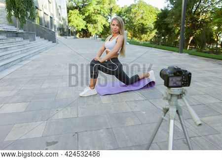 Sport Blog. Attractive Young Sports Woman Working Out Outdoor, Demonstrating Exercises For Her Onlin