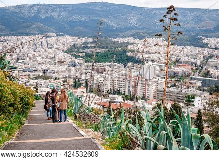 Athens, Greece - April 4 2015: Young Girls Enjoy The View From The Trail That Leads To Lycabettus Mo