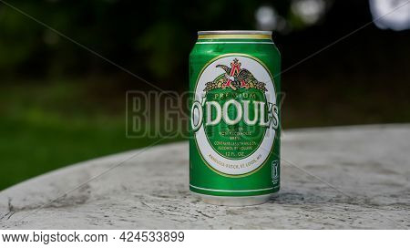 NORWALK, CT, USA - JUNE, 21, 2021: Can with O`doul`s non alcoholic beer on outdoor table in summer