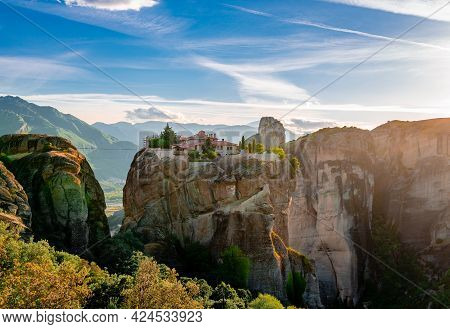 The Monastery Of The Holy Trinity, In Meteora, Greece. Scenic Landscape In The Sunset.