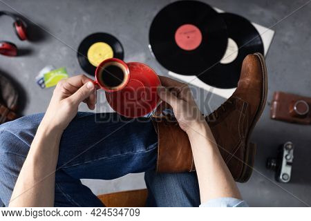 Man and hand holding cup of coffee thinking idea. Male fashion and art music life style concept