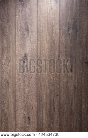 Dark laminate floor background texture.   Wooden laminate floor or wood wall with copy space