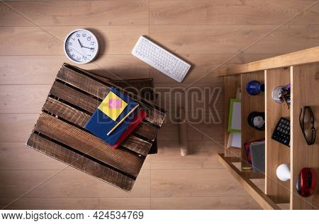 Stack of wooden box and furniture on floor laminate background. Wood shelving and boxes crate top view