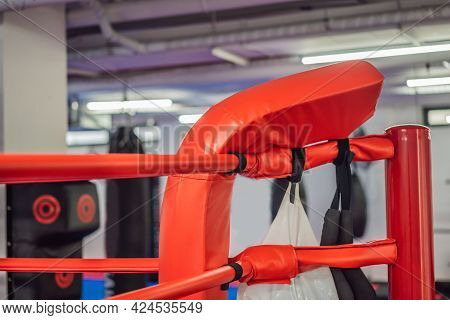 Boxing Equipment On The Ropes Of A Boxing Ring