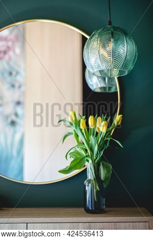 Dressing table with elegant round mirror. Interior design and home staging
