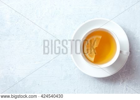 Tea With Lemon, A Simple Infusion. Healthy Citrus Hot Drink, Shot From The Top With Copy Space On A