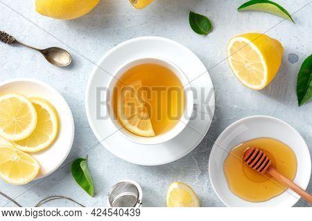 Lemon Tea With Honey, Overhead Flat Lay Shot. Organic Lemons, Green Leaves And The Natural Remedy Of
