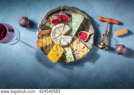 Cheese Platter With Wine And Fruit, Shot From The Top On A Blue Background With A Place For Text. Di