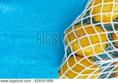 Yellow Lemons In The Eco Friendly Bag On The Blue Blanket Outdoor. Eco Modern Shopper With Citrus. B