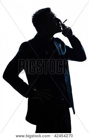 one caucasian man portrait smoking cigarette silhouette in studio isolated white background