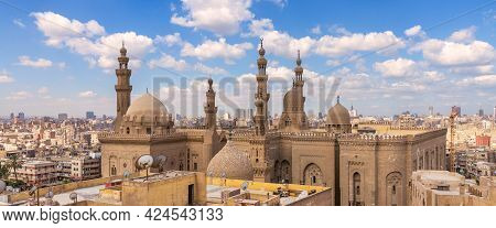 Aerial Day Shot Of Minarets And Domes Of Sultan Hasan Mosque And Al Rifai Mosque Mediating Shabby Bu