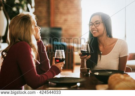 Friends having red wine at a dinner party