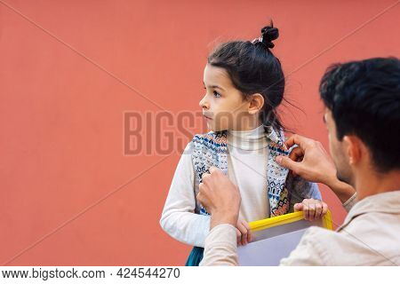 A Loving Father Meeting His Little Girl After School. Father Enjoying The Time Together With His Chi