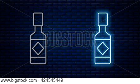 Glowing Neon Line Tabasco Sauce Icon Isolated On Brick Wall Background. Chili Cayenne Pepper Sauce.