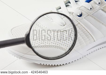 The Buyer Searches For Defects And Macro Detail In Shoes With Magnifying Glass. Style And Fashion Sn